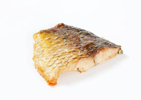 ovenbaked: Oven-baked carp fillet - studio shot