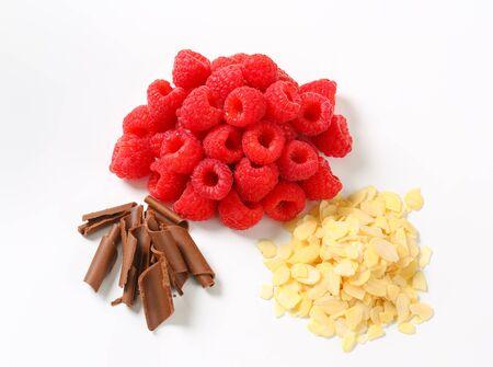 chocolate curls: Heaps of fresh raspberries, chocolate curls and sliced almonds