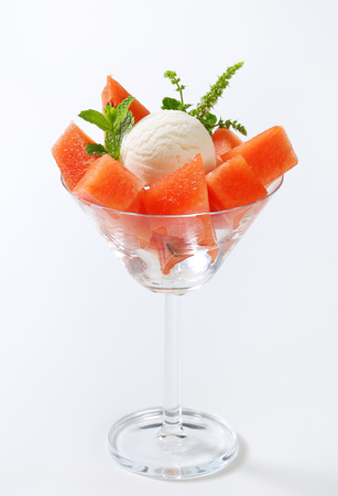 diced: Scoop of white ice cream with diced watermelon Stock Photo
