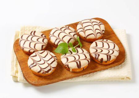 glaze: Mini cakes with white chocolate glaze Stock Photo