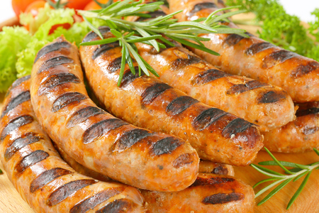 veal sausage: Grilled bratwursts on cutting board