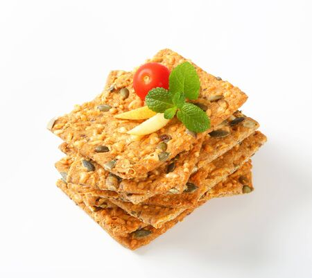 whole grain: Whole grain crackers with cheddar and pepitas Stock Photo