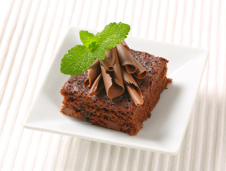 curls: Brownie topped with chocolate curls Stock Photo