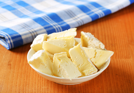 penicillium: Pieces of French white rind cheese in a bowl
