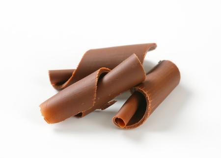 milk chocolate: Chocolate curls on white background