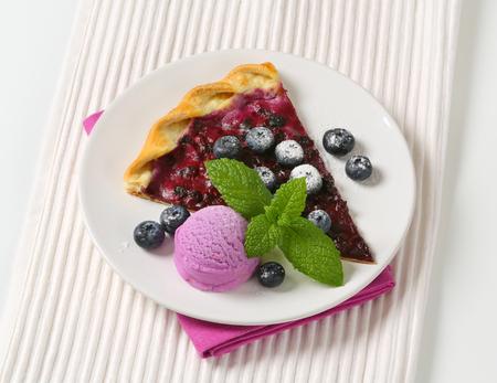 quark: Slice of quark and blueberry flammkuchen with ice cream Stock Photo