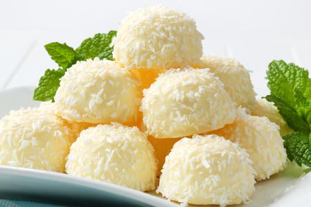 boule de neige: Pile of coconut snowball truffles on square plate