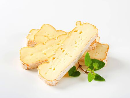 munster: Slices of Alsatian Munster cheese Stock Photo