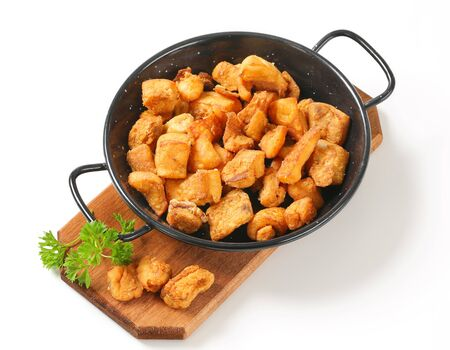 greaves: Crispy fried pork greaves in a skillet Stock Photo