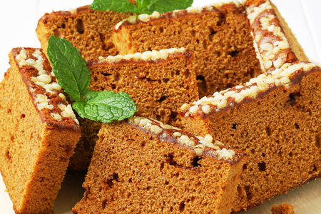 spice cake: Slices of spice cake on cutting board Stock Photo