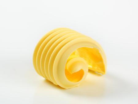 mantequilla: Curl de mantequilla fresca Foto de archivo