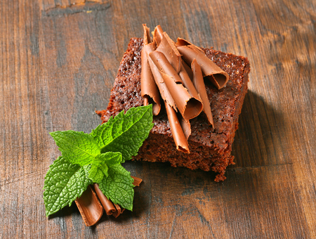 chocolate curls: Brownie garnished with chocolate curls Stock Photo