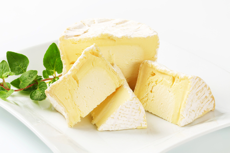 rind: Wedges of French white rind cheese Stock Photo