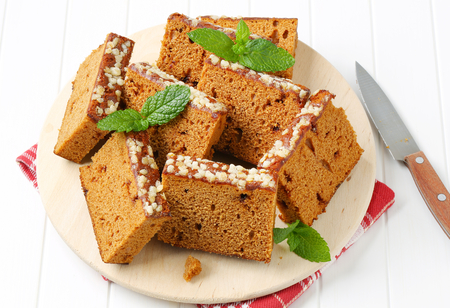 spice cake: Slices of spice cake on round cutting board Stock Photo