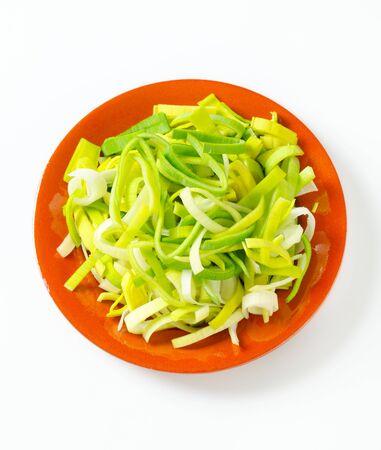 leek: Fresh chopped leek on plate