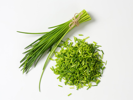 green herbs: Studio shot of fresh chives - bunch and chopped Stock Photo