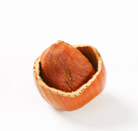 nutshell: Hazelnut in a cracked nutshell Stock Photo
