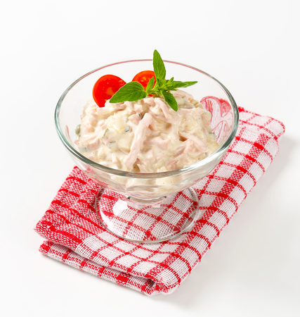 potato salad: Ham and potato salad in a glass serving bowl Stock Photo