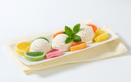 fruit plate: Scoops of white ice cream garnished with jelly candy