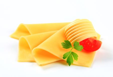 edam: Thin slices of yellow cheese and butter curl