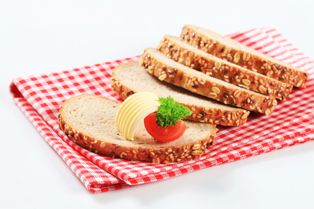 sesame seeds: Sliced bread topped with flax and sesame seeds