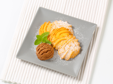 Spritz butter cookies and scoop of chocolate ice cream