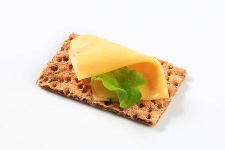 whole grain: Whole grain crispbread with slice of cheese Stock Photo