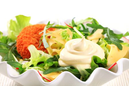 gronostaj: Green salad with fried breaded cheese and sliced Swiss cheese and mayonnaise Zdjęcie Seryjne