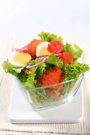 boiled egg: Fresh salad with fried breaded cheese and sliced boiled egg