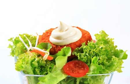 gronostaj: Green salad with fried breaded cheese and mayonnaise