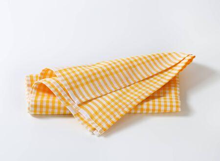 dishcloth: Checked yellow linen tea towel Stock Photo