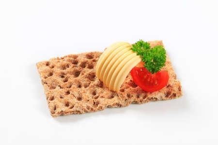 whole grain: Whole grain crisp bread with butter Stock Photo