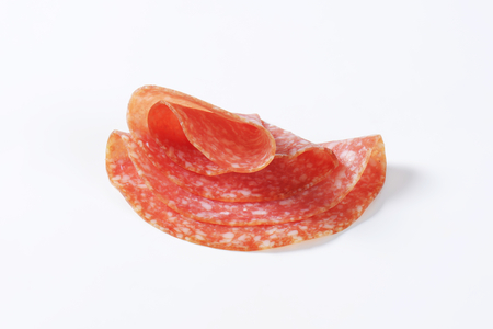 thinly: Thinly sliced salami - studio shot