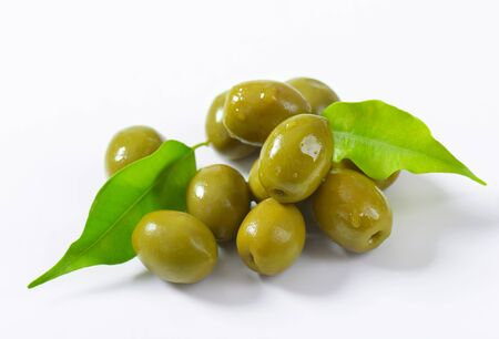 cured: Unpitted brine cured green olives Stock Photo