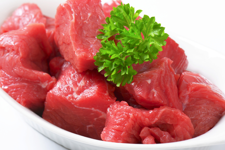 diced: Raw diced beef in a  porcelain bowl