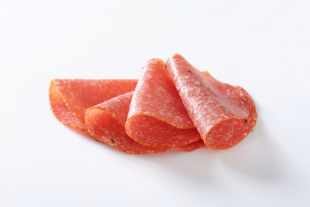 salame: Thinly sliced salami infused with pieces of black truffles Stock Photo