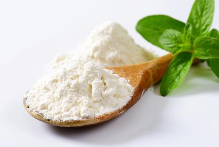 Wheat flour on wooden spoon