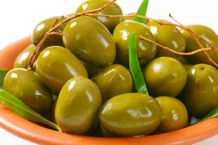 accompaniment: Bowl of fresh green olives