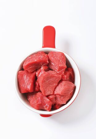 diced: Raw diced beef in a pan