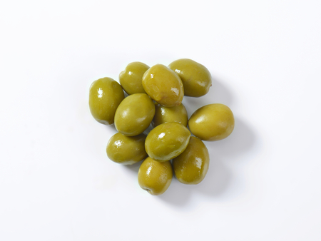 green olive: Unpitted brine cured green olives Stock Photo