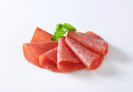 thinly: Thinly sliced salami infused with pieces of black truffles Stock Photo