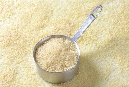 long shots: Uncooked Jasmine rice in a saucepan
