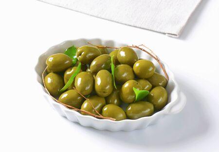 green olives: Fresh green olives in ceramic dish