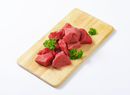 diced: Raw diced beef on cutting board