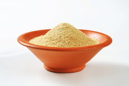 breadcrumbs: Bowl of dry bread crumbs Stock Photo