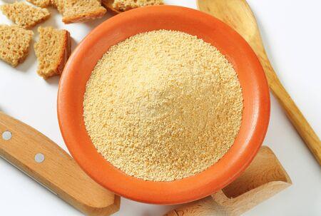 crumbing: Bowl of dry bread crumbs Stock Photo