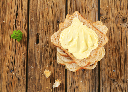 whole wheat bread: Slices of sandwich bread and butter