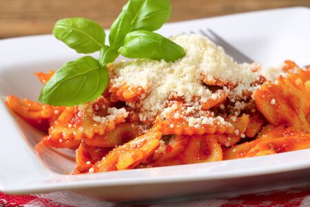 pastasciutta: Bow-tie pasta with tomato sauce and parmesan