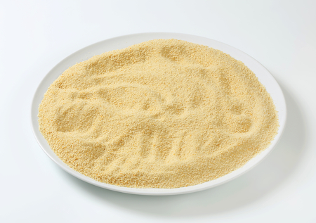 breading: Dry bread crumbs on plate Stock Photo