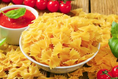 tomato puree: Uncooked bow tie pasta and tomato puree